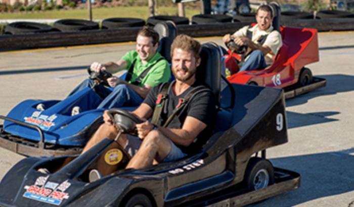 people riding go-carts at Broadway Grand Prix