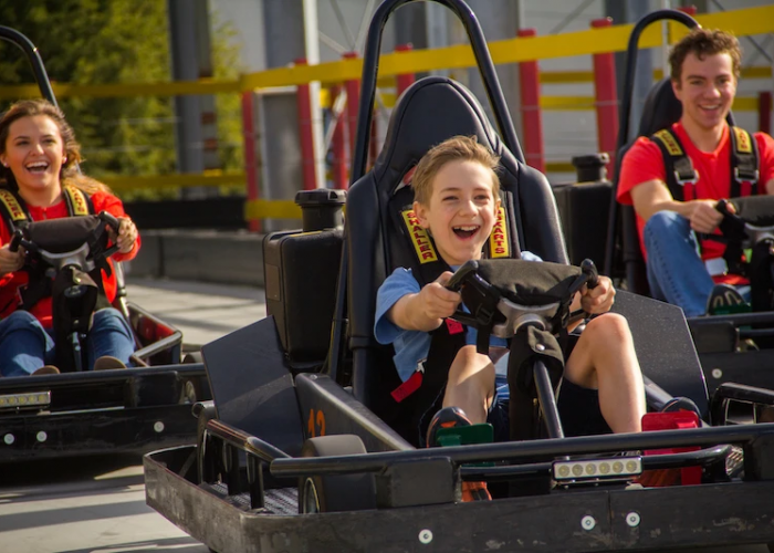 Family racing go-carts at The Track