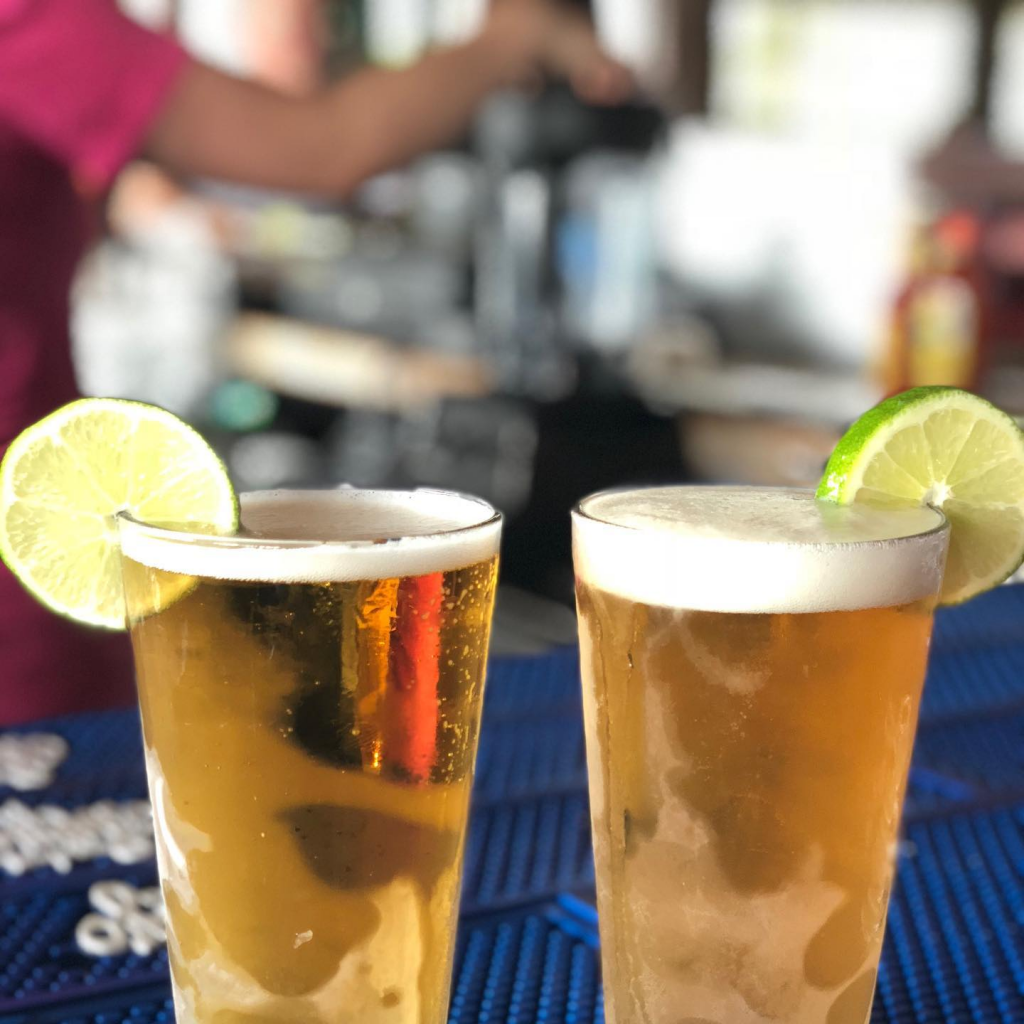 Two pints of beer at a cantina