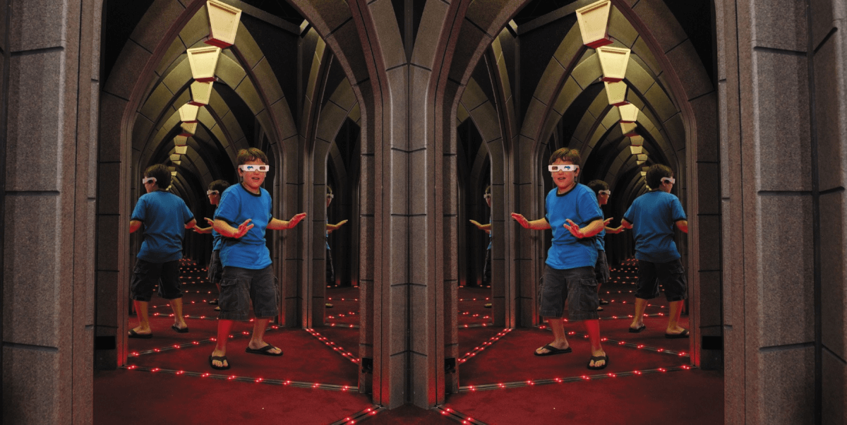 Boy navigating Ripley's Marvelous Mirror Maze