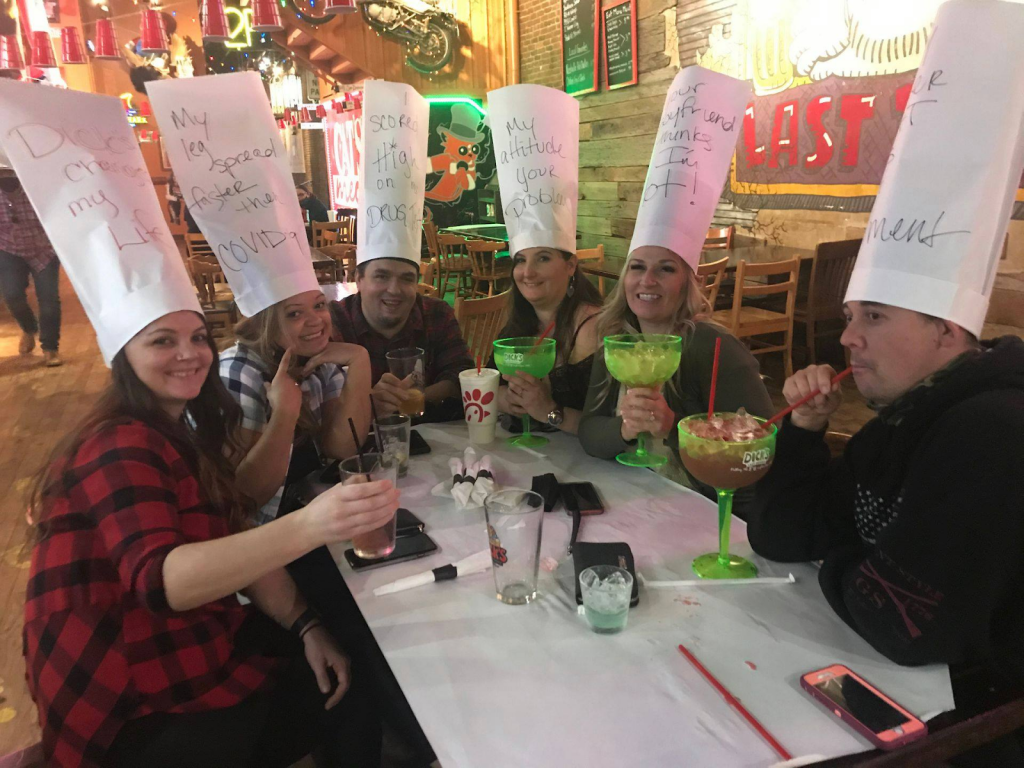drinks and sarcastic hats at Dick's Last Resort