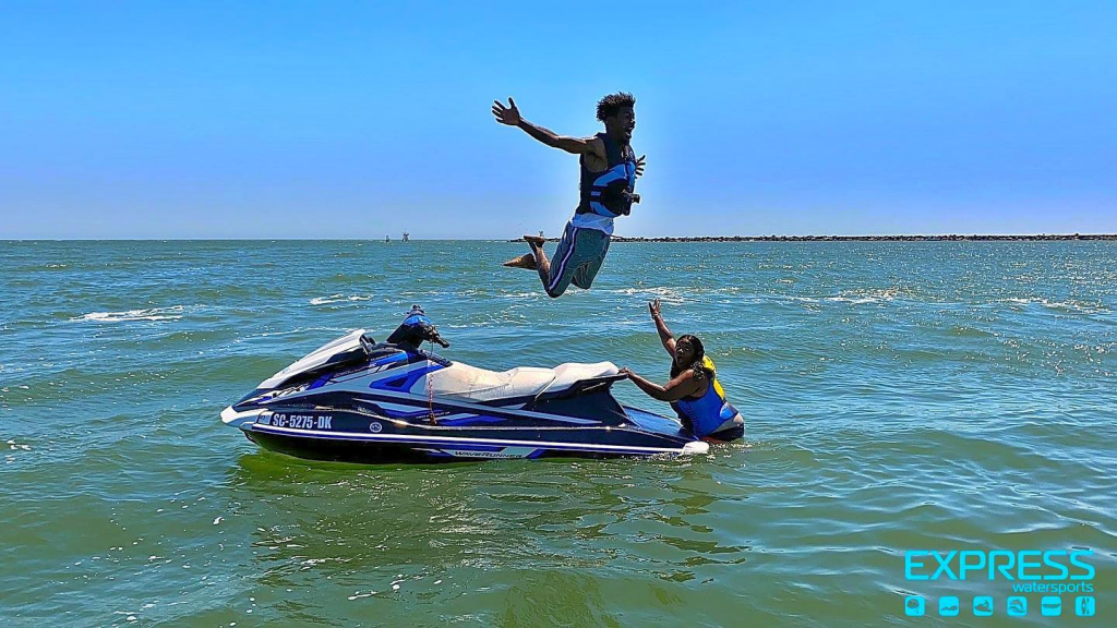 Man jumping off jet ski
