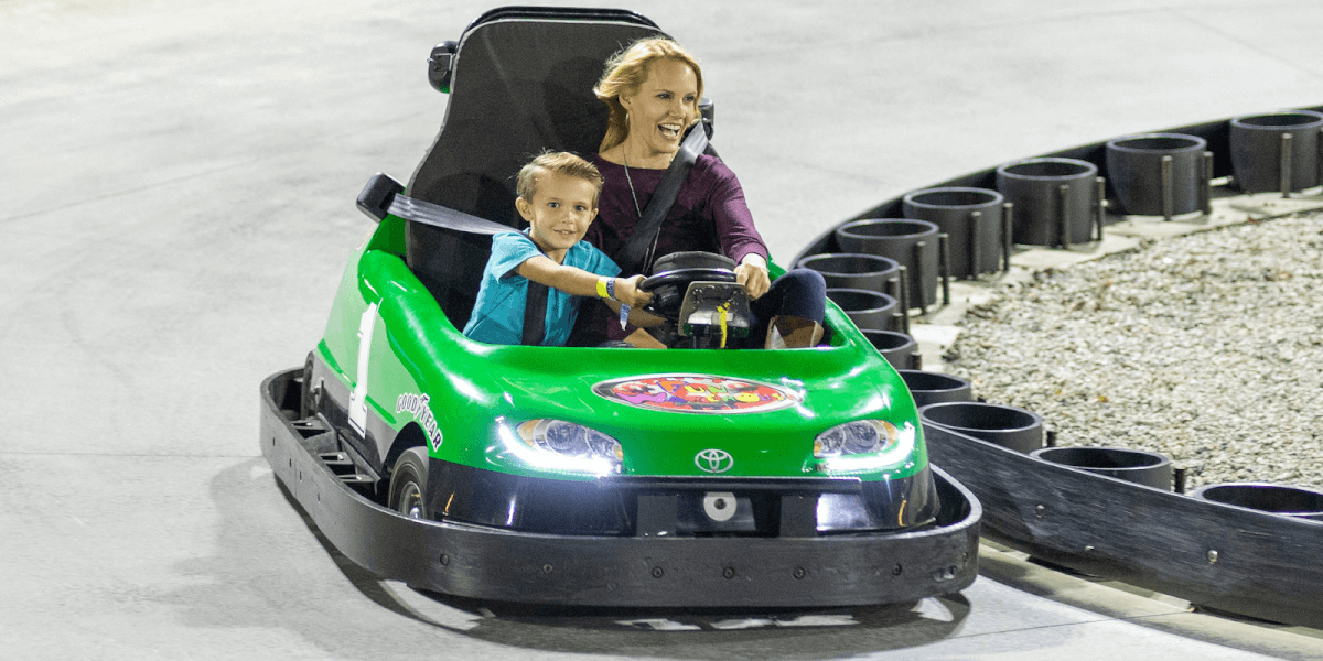 Mom and son driving go-kart at the Fun Warehouse in Myrtle Beach