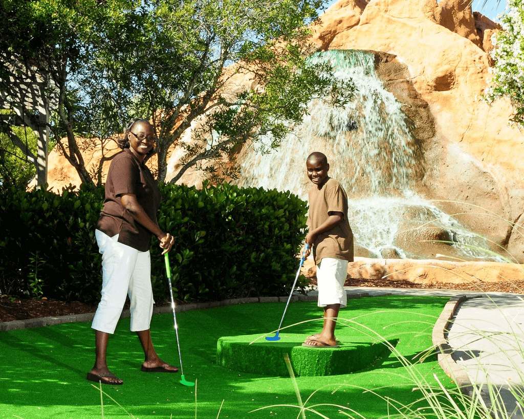Mom and son playing miniature golf