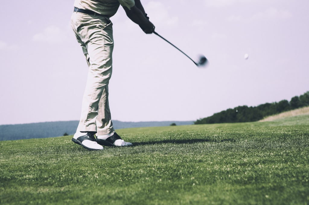 A golfer swings his club - Prestwick Country Club