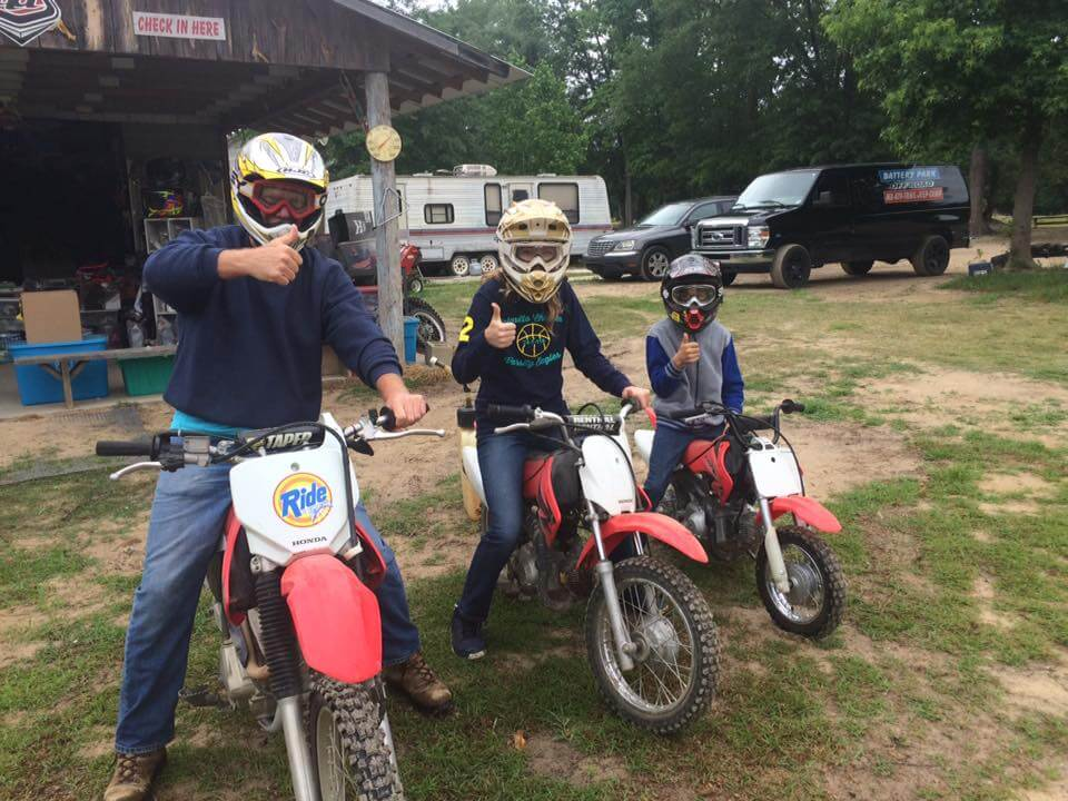 Family riding dirt bikes at Battery Park Off-Road