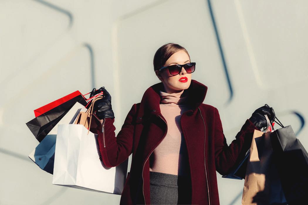 Woman in stylish dress shopping