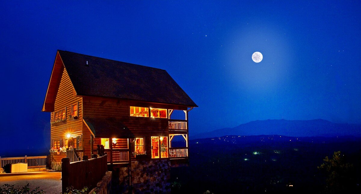 HearthSide Cabin Rentals Exterior Cabin at Night