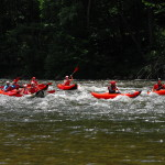 Kayakers on the river from Smoky Mountain Outdoors Whitewater Rafting