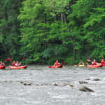 A group of kayakers on the river at Smoky Mountain Outdoors Whitewater Rafting