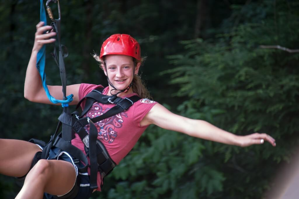 Foxfire Mountain Zip Lines Girl Hanging