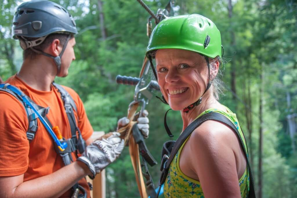 Foxfire Mountain Zip Lines Girl Smiling with Green Helmet