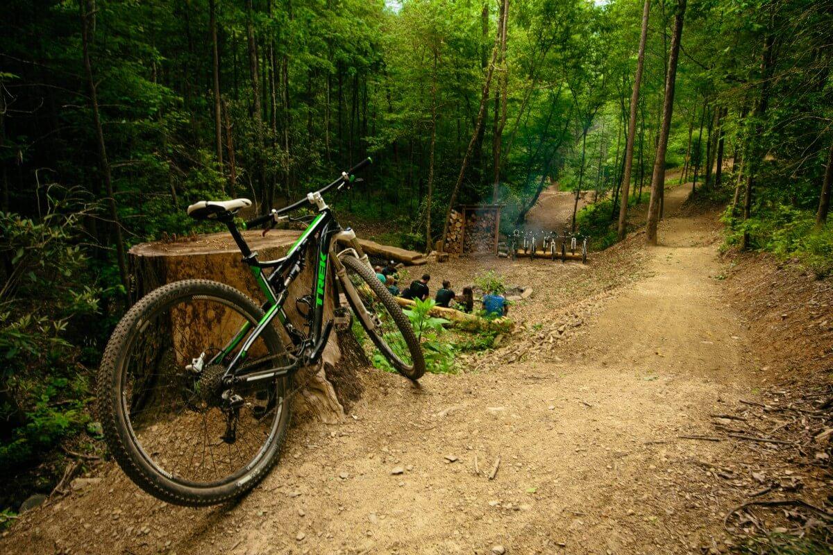 Bike resting against a log at Climbworks Mountain Bike