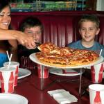 Geno's Pizza - Mom Serving Pizza