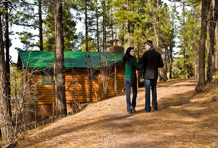 Couple Walking Near Cabin
