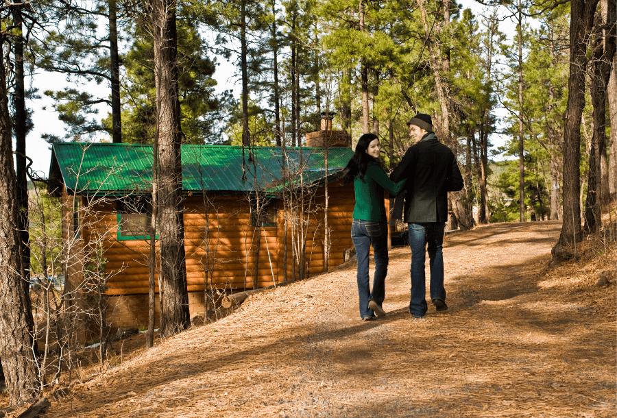 Couple Walking Near Cabin