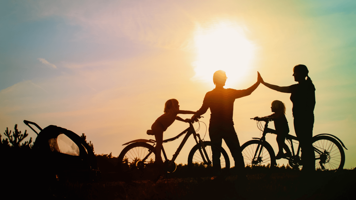 Family with children riding bikes