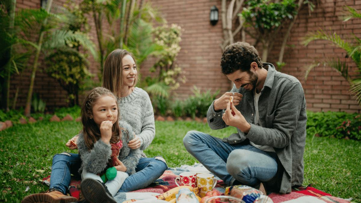 Family picnicking in backyard
