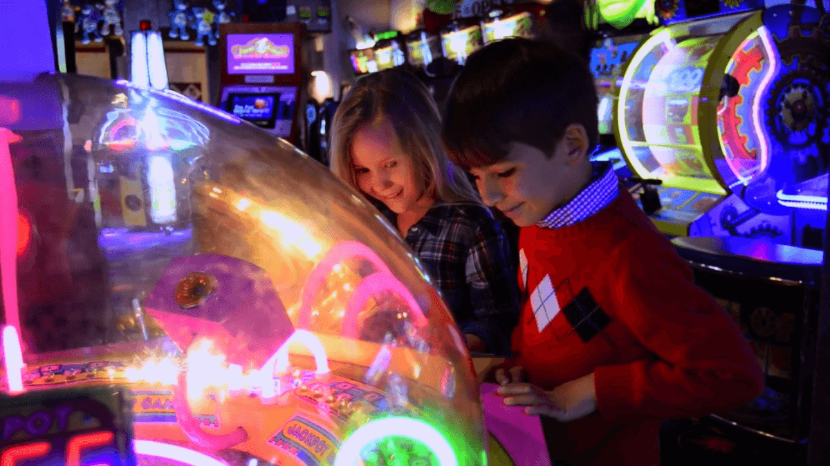 children playing an arcade game at Fannie Farkle's