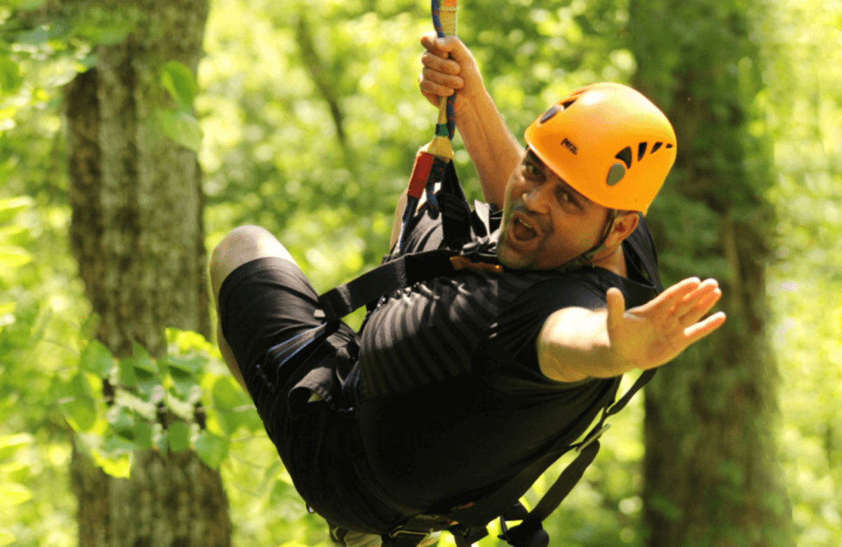 Man ziplining at Wahoo Ziplines