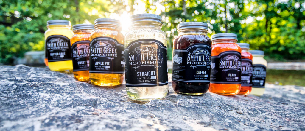 lineup of various flavors - Smith Creek Moonshine