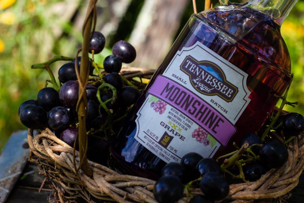 bottle of grape moon shine - Tennessee Legend Distillery