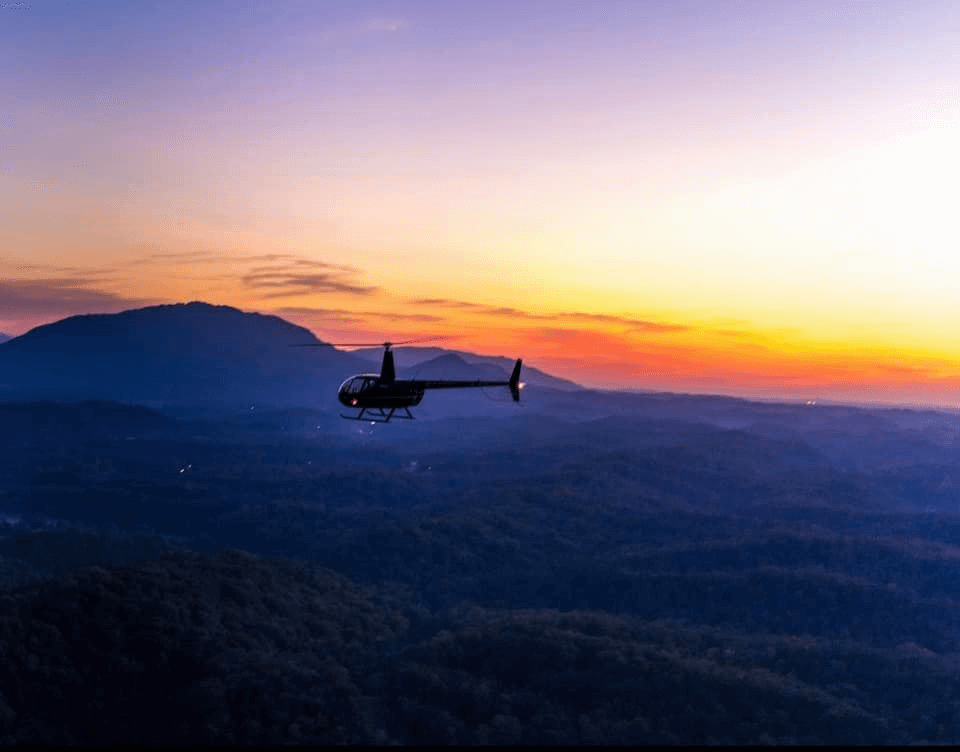 helicopter flying over Smoky Mountains