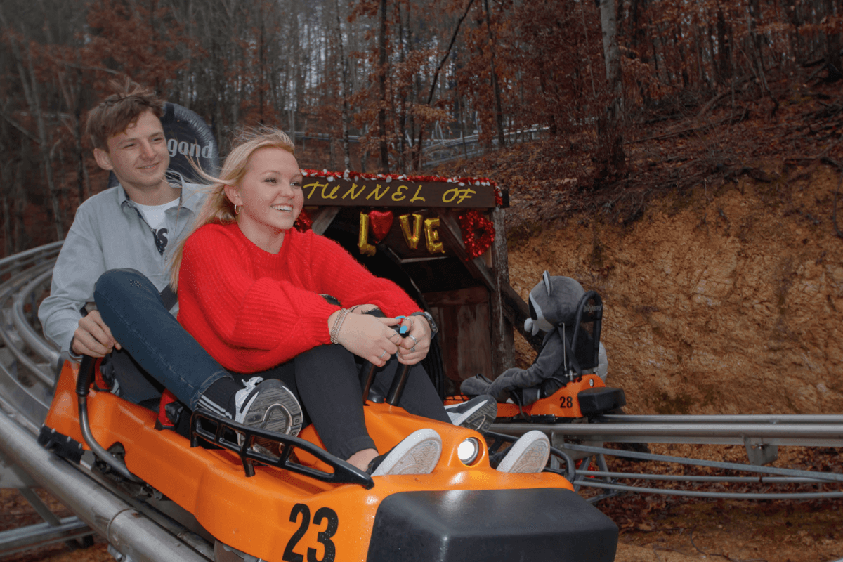 Couple riding the Rocky Top Mountain Coaster in Pigeon Forge