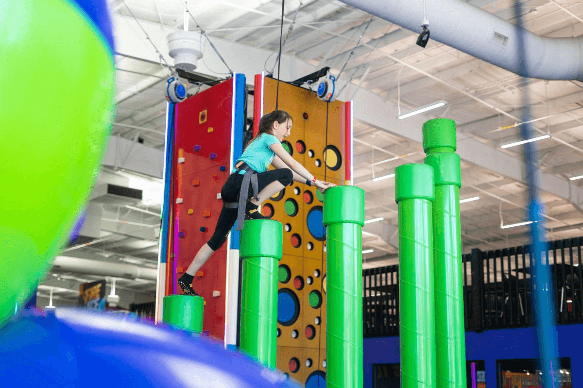 Girl climbing obstacles at TopJump Trampoline & Extreme Arena