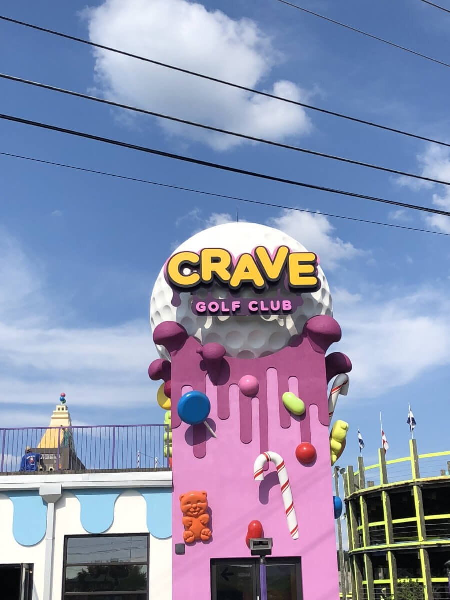Family playing mini golf at Crave Golf Club - Pigeon Forge