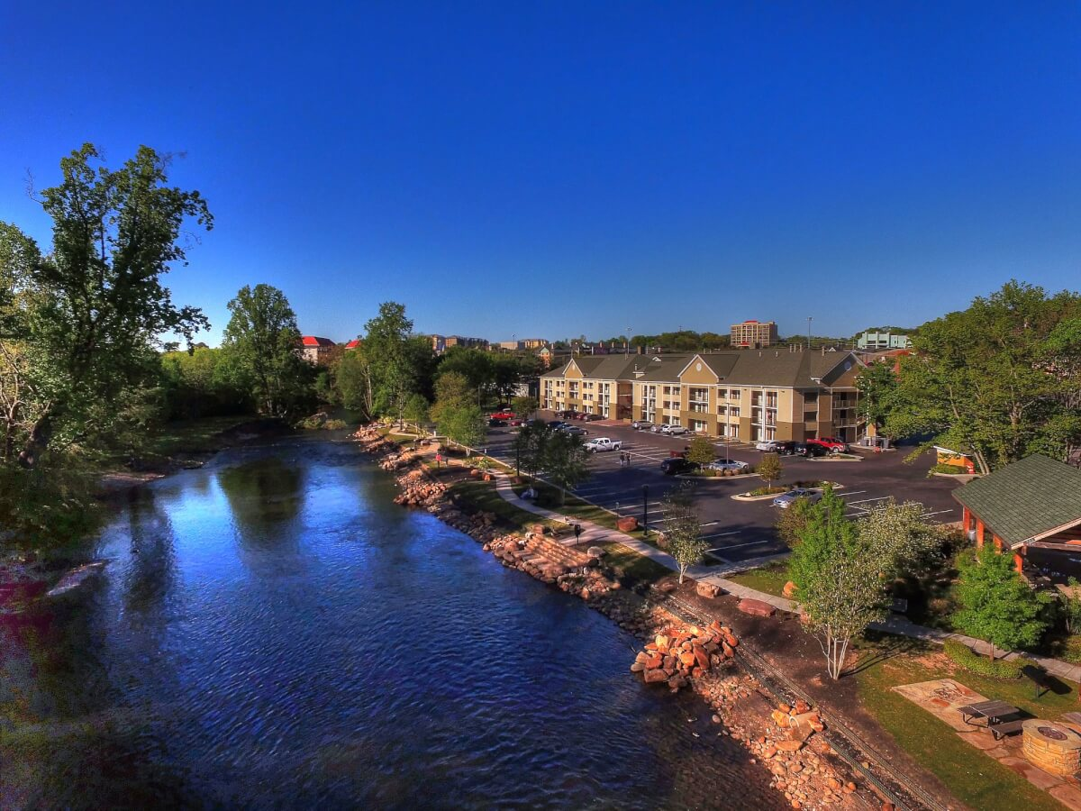 exterior view by river - EconoLodge Pigeon Forge