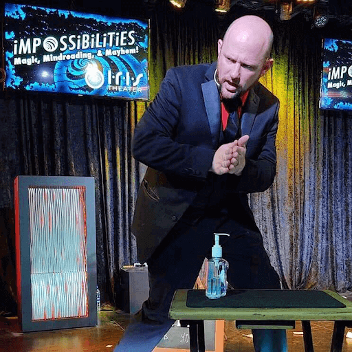 magician performing at Impossibilities Magic Show