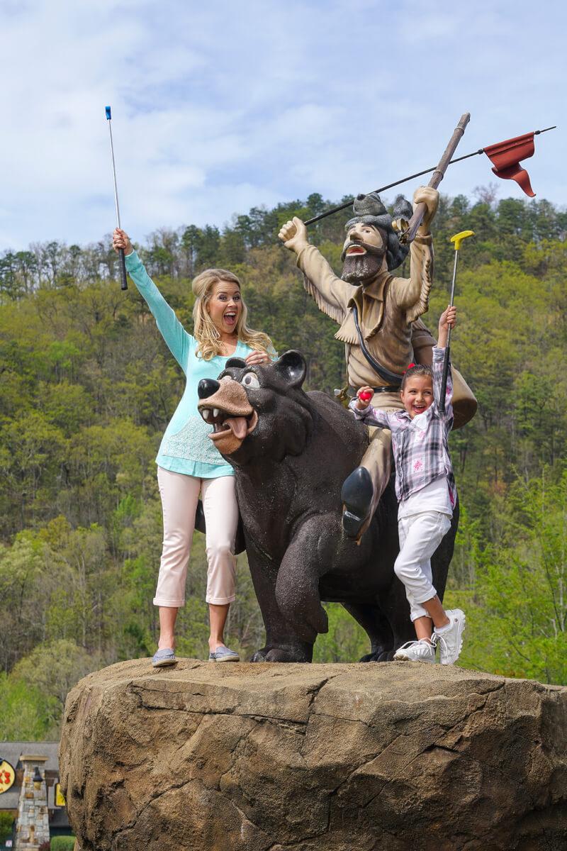Friends putting at Ripley's Davy Crockett Mini-Golf