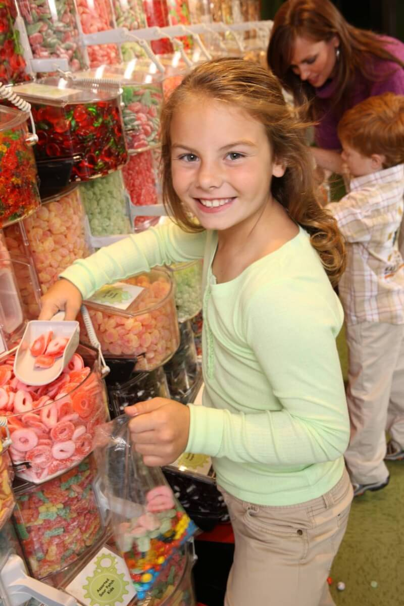 Child scooping candy at Ripley's Candy Factory