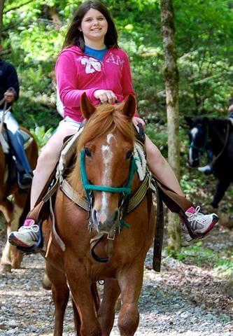 girl riding horse at Sugarlands Riding Stables - Gatlinburg