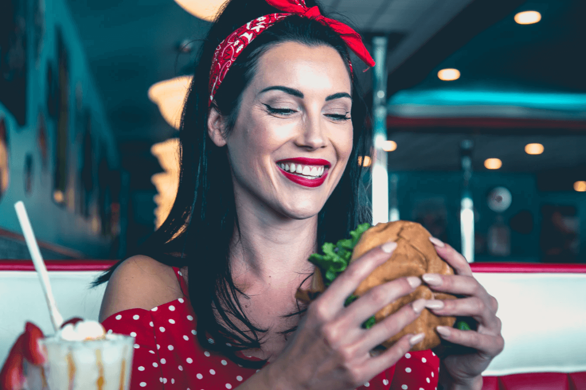Lady eating burger at The Diner of Sevierville, TN