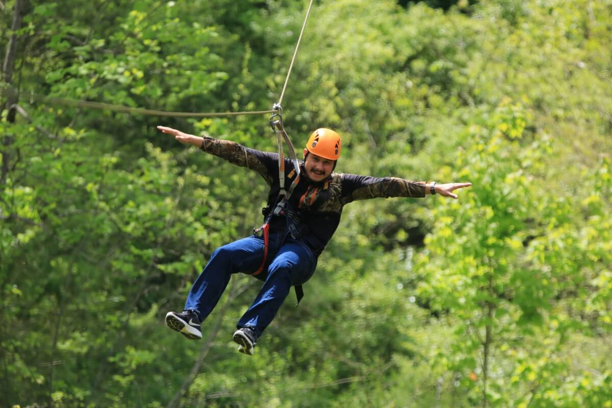 Man ziplining at Wahoo Ziplines